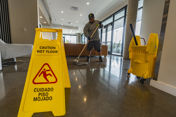 janitor mopping the floor at a commercial building